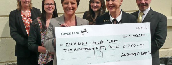 Anthony Clark's conveyancing department with Diane White presenting the cheque to Macmillan Cancer Support.