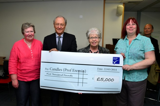 Representitives from Lincoln College Student Services give £5k to Candles, who support the research of Professor Eremin. Photo: Steve Smailes for The Lincolnite