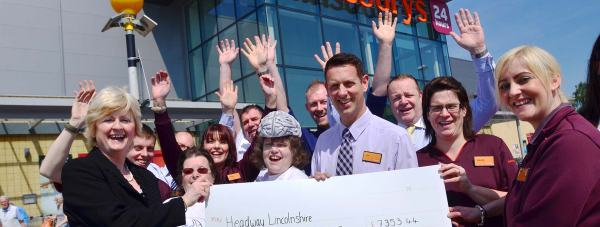 Representatives from Tritton Road Lincoln Sainsbury's presented their charity of the year, Headway Lincolnshire, with donations raised by customers. Photo: Steve Samiles for The Lincolnite