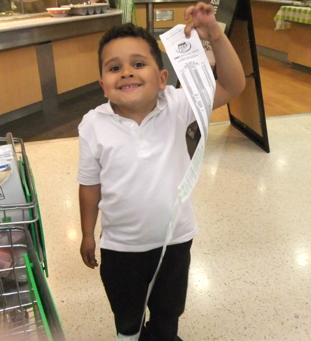 Theo's shopping receipt was almost as tall as him.
