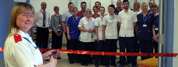 Rosie Brennan, the longest serving staff member of the Lincoln A&E department, opens the new resuscitation room. Photo: ULHT