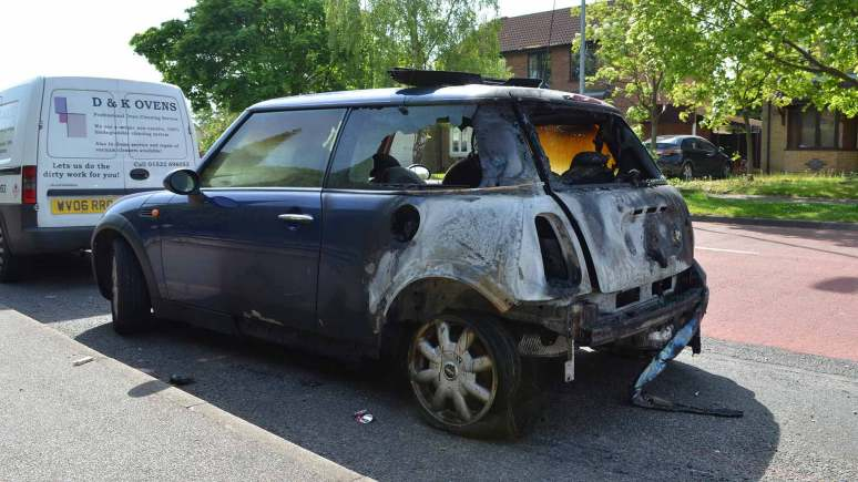 The Mini Cooper after the fire on Fulmar Road in Lincoln on May 5, 2014.
