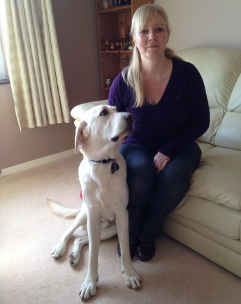 Catherine and her guide dog Moss.