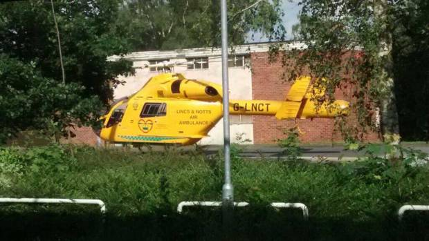 The air ambulance awaiting the biker to be transported to hospital. Photo: Sian Wright