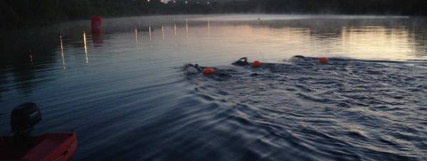 Paul Fowler, Martin Ball and Alex Ferguson swimming in the lake at Activities Away in North Hykeham during a overnight training session.