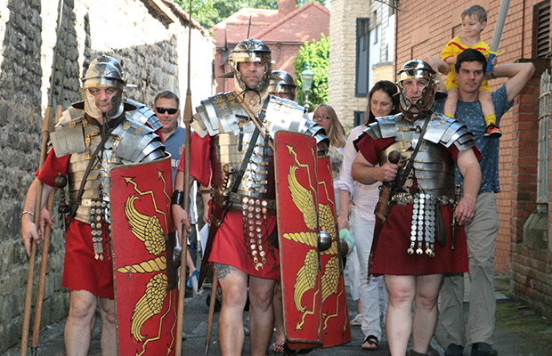 The Ermine Street Guard lead the first visitors around the Roman Trail. Photo: Tony Barker
