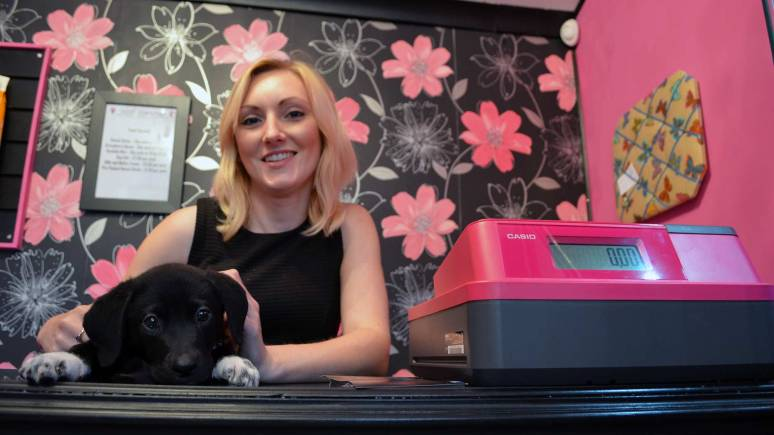 Suzie Barkworth, boutique owner with puppy Dempsey.