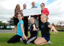 Community spirit: Back row from left, Sally Harrison  from Barchester, Matthew Gillett, Jaime Saunders (head coach at Witham Gymnastic Club) and Helen Wilson (General Manager of Tennyson Wharf) and bottom row from left, are Witham club members, Skye Fox (13),  Jasmine Gillett (12) and  Elisha Barnes (11).