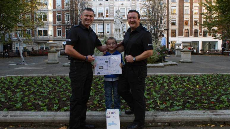 PC Jon Peacock and PC Rich Precious with Jayden and his board game idea.