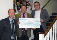 Karl hands over cheque to One Me representatives.