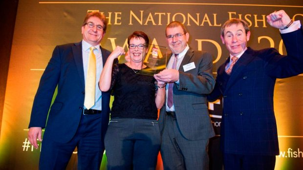 Burton Road Chippy co-owners Lesley Graves and Des Anastasiou (middle) celebrating a double win with awards host BBC Radio 2's Nigel Barden and awards sponsor Philip Blakeman, Managing Director of James T Blakeman & Co Ltd.