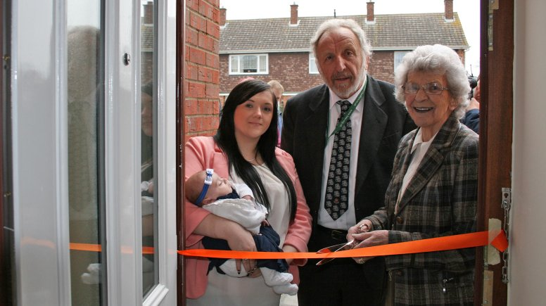NKDC Council Leader Cllr Marion Brighton OBE, Cllr Stewart Ogden Executive Board Member for Housing and Emma and Elsie Fahy, outside Emma's new house.