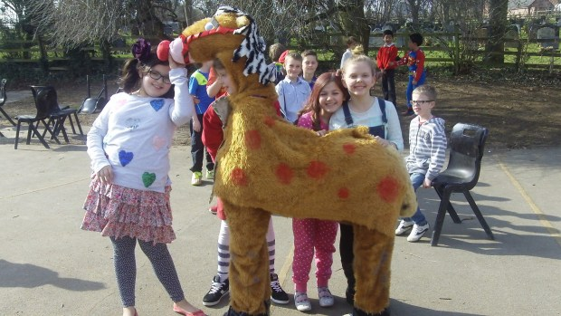 Children and staff at Nettleham Church of England Aided Junior School dressed up, baked cakes, bought 600 red noses.