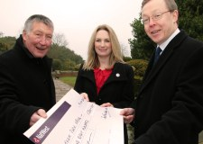 Louise Cotton from Linkage receives the cheque from Stephen Tointon (left) and Neil McDowall of Saul Fairholm.