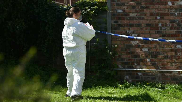 Fornesic investigators at the scene of the stabbing in Walnut Place in Lincoln.