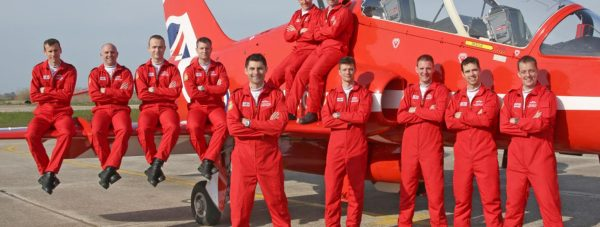 Pilots of the 2015 Royal Air Force Aerobatic Team, the Red Arrows, next to one of their Hawk T1 jets after getting formal approval to display this season. MoD/Crown Copyright 2015