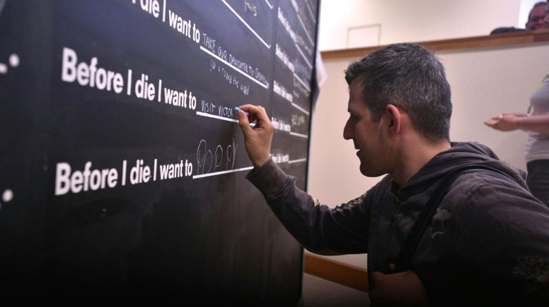 Shoppers are listing their dreams on the Before I die board at the Waterside Shopping Centre. Photo: Steve Smailes for The Lincolnite