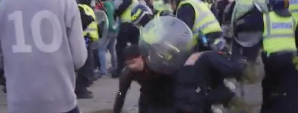 Throughout the night, the police are shown trying to push back the line of people at the illegal rave, with continued taunts and bottles thrown from the crowd. Screenshot: Chris Shaw