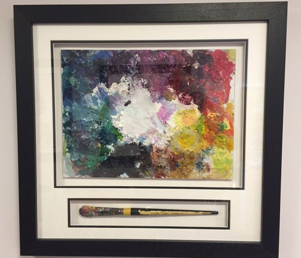 The palette and signed paintbrush Katy is auctioning on eBay