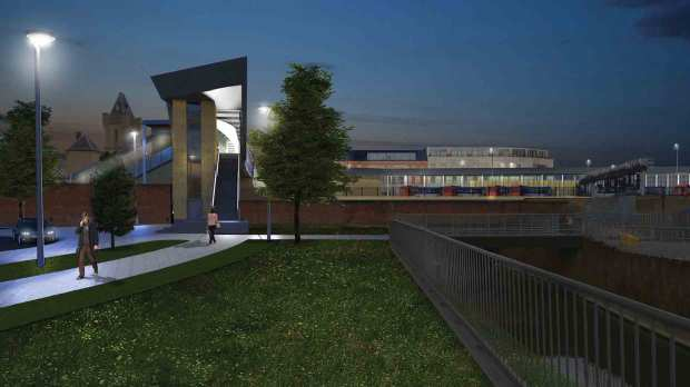A view at night of the new footbridges that the scheme would bring if approved.