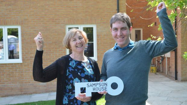 Former house manager Sue Taylor handing over the keys to Philip Williams, who will be moving into the new apartments