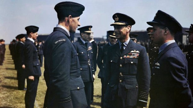The visit of HM King George VI to No 617 Squadron (The Dambusters), Royal Air Force, Scampton, Lincolnshire, May 27, 1943 - The King has a word with Flight Lieutenant Les Munro from New Zealand. Wing Commander Guy Gibson is on the right and Air Vice Marshal Ralph Cochrane, Commander of No 5 Group is behind Flight Lieutenant Munro and to the right.