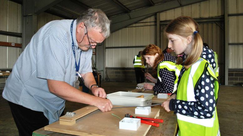 Elle Barnaby from Dunholme St Chad's school learning the tricks of the trade.