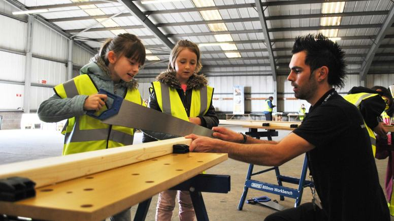 Faith Lawless and Matilda Hudson from St Faith St-Martin  school with Dale Brader, Instructor in Carpentry at Lincoln College.