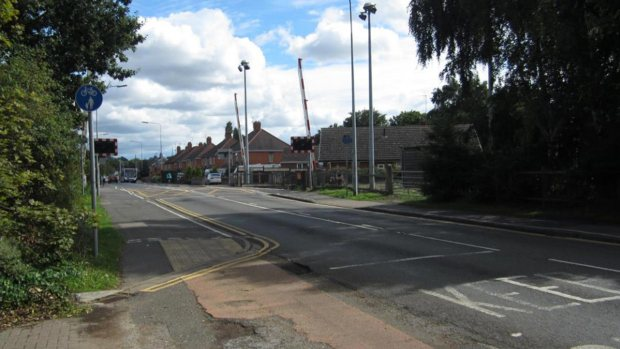 Looking towards the railway crossing from the entrance to the site