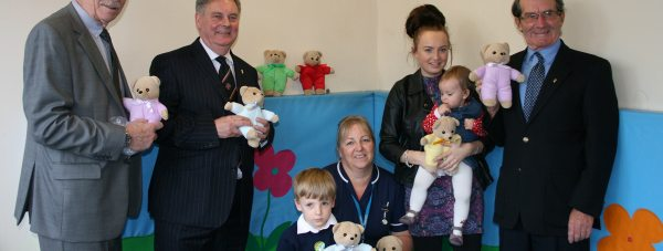 Members of the Lincolnshire Freemasons with Karen Hansord,  senior sister in A&E, Troy Birkett and Molly Webber with her daughter.
