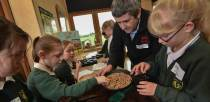 Stephen Ward from Uncle Henry's helping pupils planting the seeds. Photo: Steve Smailes for The Lincolnite