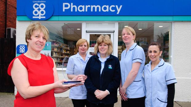 Avril McDermott, Tracy Pearce, Dee Buckberry, Louise Hubbard and Karen Sutton outside the Rookery Lane Pharmacy. Photo: Lincolnshire Co-op