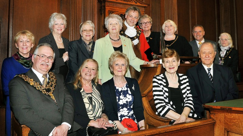Group pix of Candles' trustees and volunteers celebrating success with members of the Lincoln Civic Party