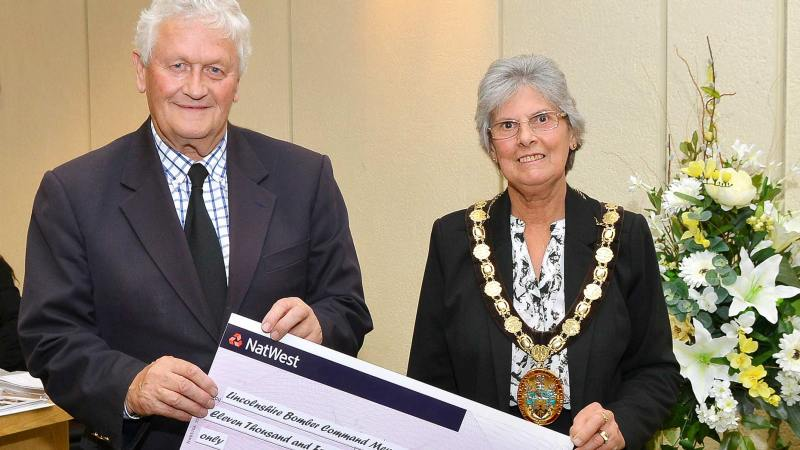 Councillor Gill Ogden presenting a cheque to Tony Worth of the International Bomber Command Centre. Photo: North Kesteven District Council