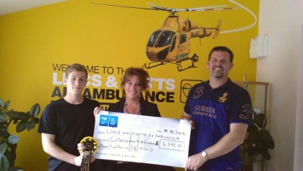 Daniel and Chris Clarkson presenting cheque to CEO Karen Jobling