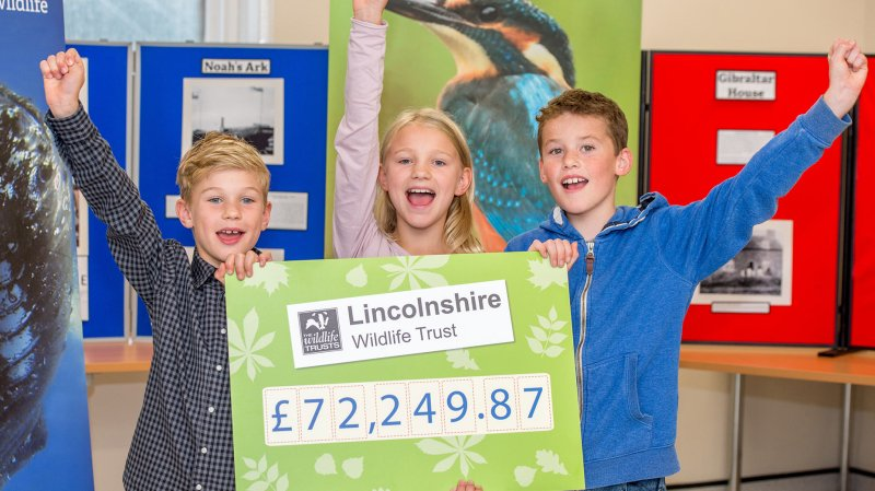 (L-R) Youngsters at Gibraltar Point Nature Reserve celebrate the £72,249 donation to the Lincolnshire Wildlife Trust. From left, George Wilson age 8, Rhianna Wilson age 10 and Jack Eastwell age 9.