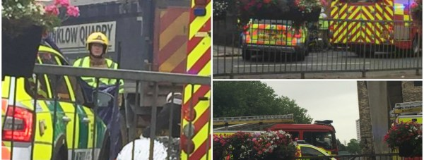 Paramedics, firefighters and police officers worked together to try to free the woman from underneath the lorry on the busy road.