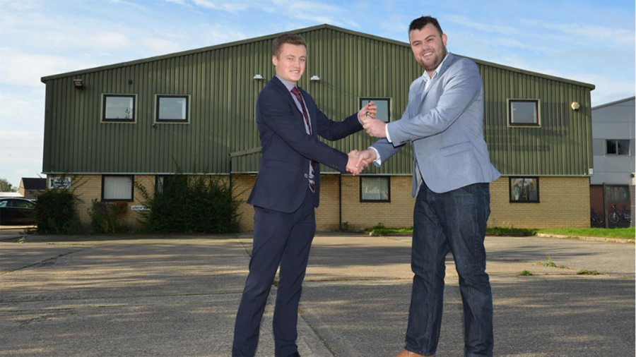YPP Managing Director Stuart Maclaren receives the keys to the new company HQ from Tim Gutteridge of Lambert Smith Hampton