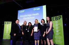 Bracebridge Heath Pre School collect their award from guest speaker David Hyner, left, Elaine Lilley, chief executive of The EBP, second in from right, and Kayleigh Wells, The EBP's work experience co-ordinator, right. Photo: Chris Vaughan