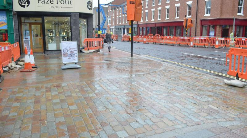New paving has been put in at the High Street junction, creating a new pedestrianised zone. Photo: Emily Norton
