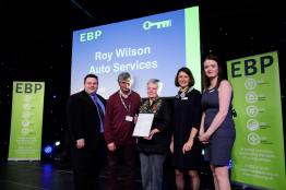 Roy Wilson Autos collect their award from guest speaker David Hyner, left, Elaine Lilley, chief executive of The EBP, second in from right, and Kayleigh Wells, The EBP's work experience co-ordinator, right. Photo: Chris Vaughan