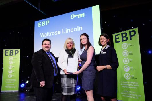 Waitrose Lincoln collect their award from guest speaker David Hyner, left, Kayleigh Wells, The EBP's work experience co-ordinator, second in from right, and Elaine Lilley, chief executive of The EBP, right. Photo: Chris Vaughan