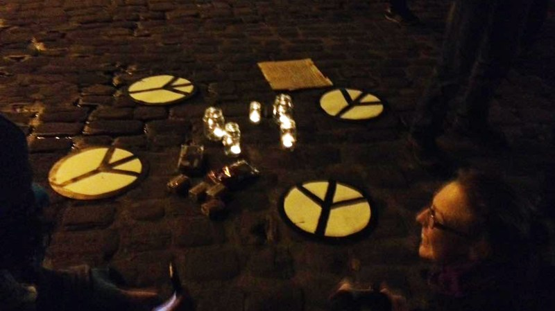 The group sat in a circle with candles and peace signs to discuss the presidential transition.