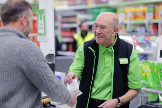 Don Wilkins didn't take to retirement so went to work full time behind the tills