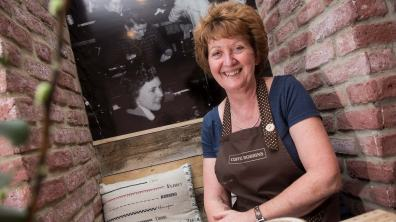 Cafe owner Christine Spencer with a photograph of her mother in the new business. Photo: Steve Smailes for The Lincolnite