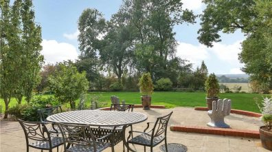 The grounds are a mixture of both formal gardens, kitchen garden, orchards, paddock and paved dining area. Photo: Humberts