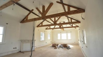 Original beams have been exposed in this top floor living space. Photo: Steve Smailes for The Lincolnite