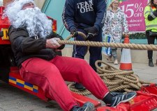 Strongman Santa pulls truck for charity