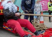 Strongman Santa pulls truck for charity