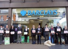 Climate protesters block bank and call for boycott